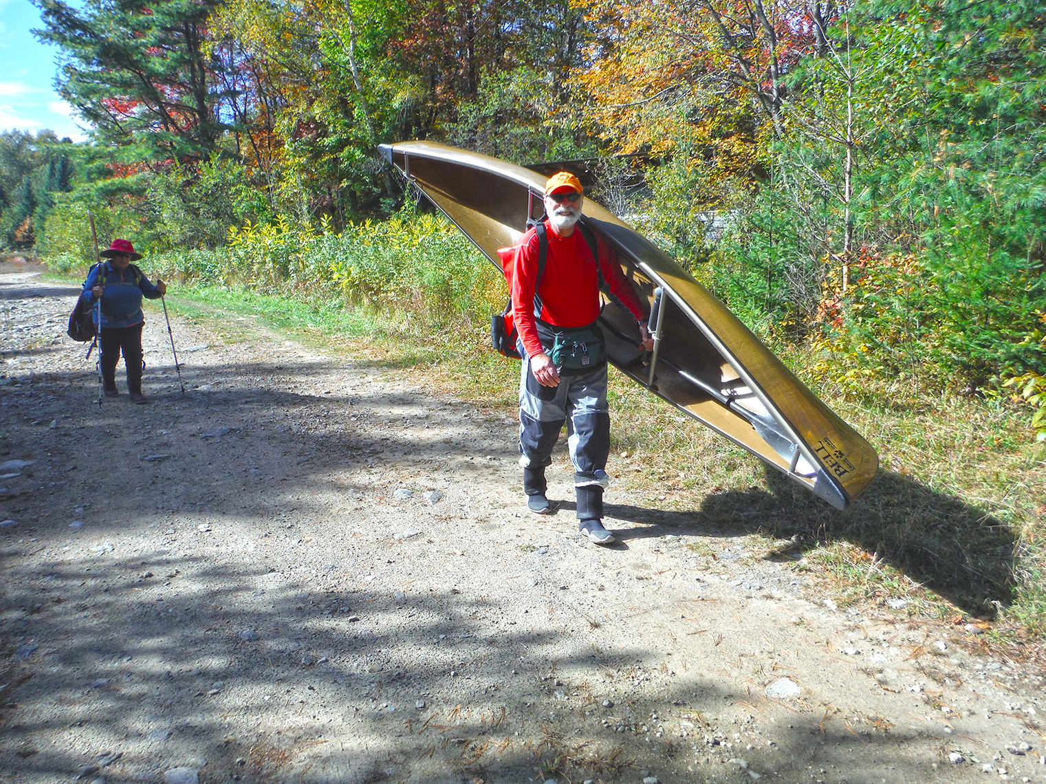 A shoulder carry on the 0.3-mile carry to the Hudson River at Polaris Bridge in the Essex Chain Lakes.  Rich Macha