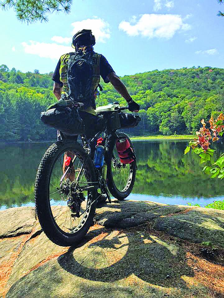 Shawne soaking in nature's beauty before the 2015 Adirondack Trail Ride.  Janay Camp