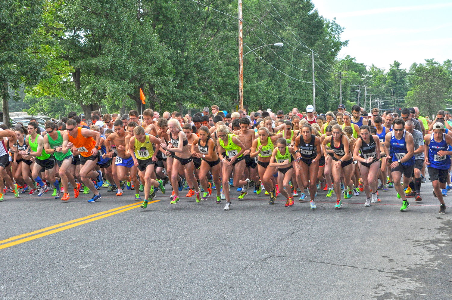And they're off! Runners begin the  2015 Silks & Satins 5K , a fast and flat course through the East Side neighbor-hood of Saratoga Springs.  Gail Stein