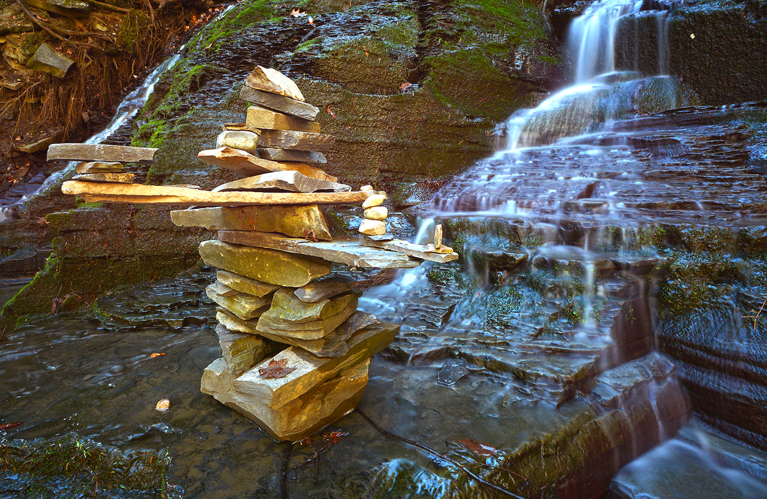 There are several impromptu sculptures like this in the ravine. This one is at the foot of the 40-foot Rynex Creek Falls. © Dave Kraus