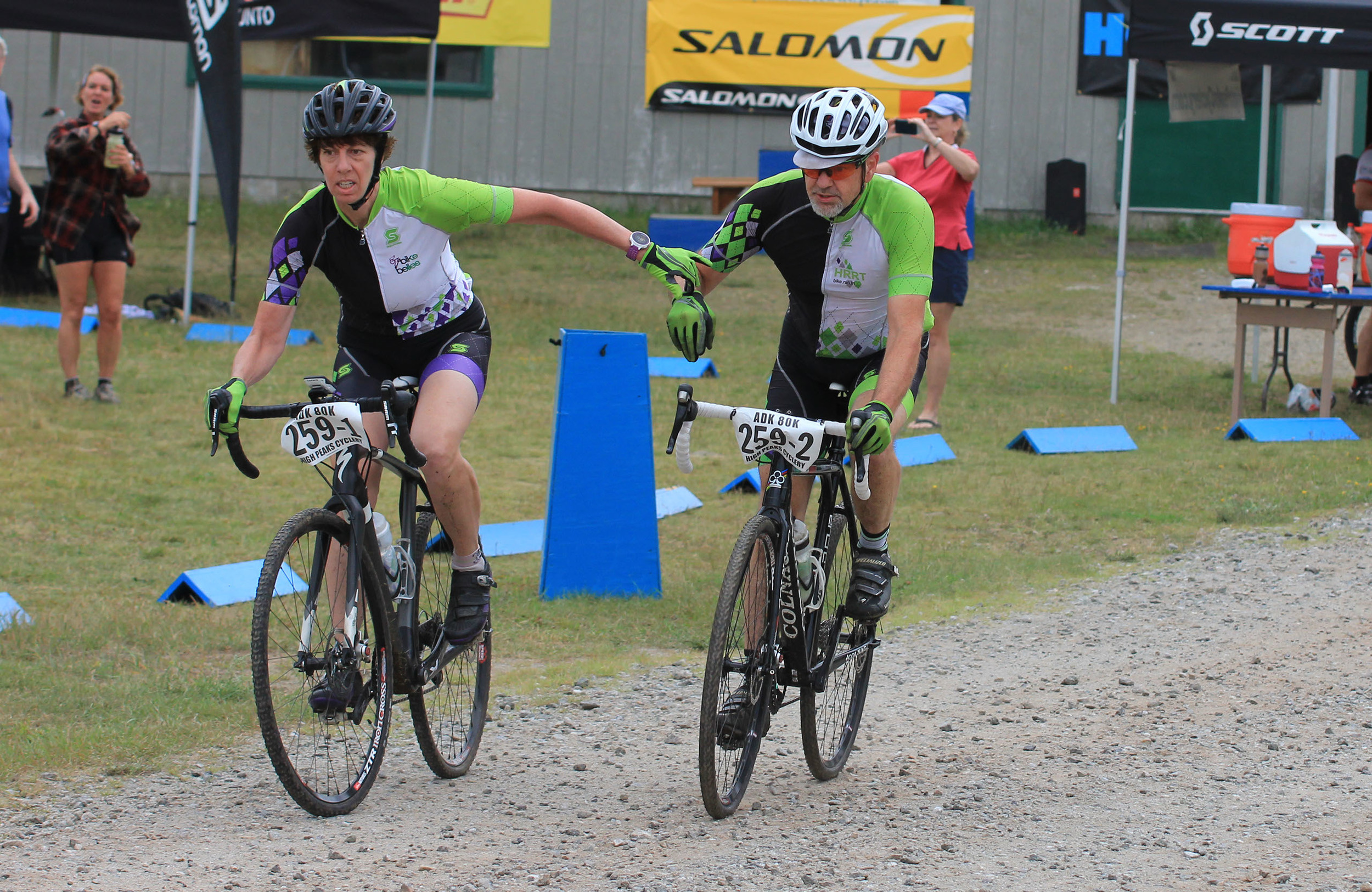 Jennifer Harvey and Don Massonne team handoff at 2015 ADK 80K.  igh Peaks Cyclery