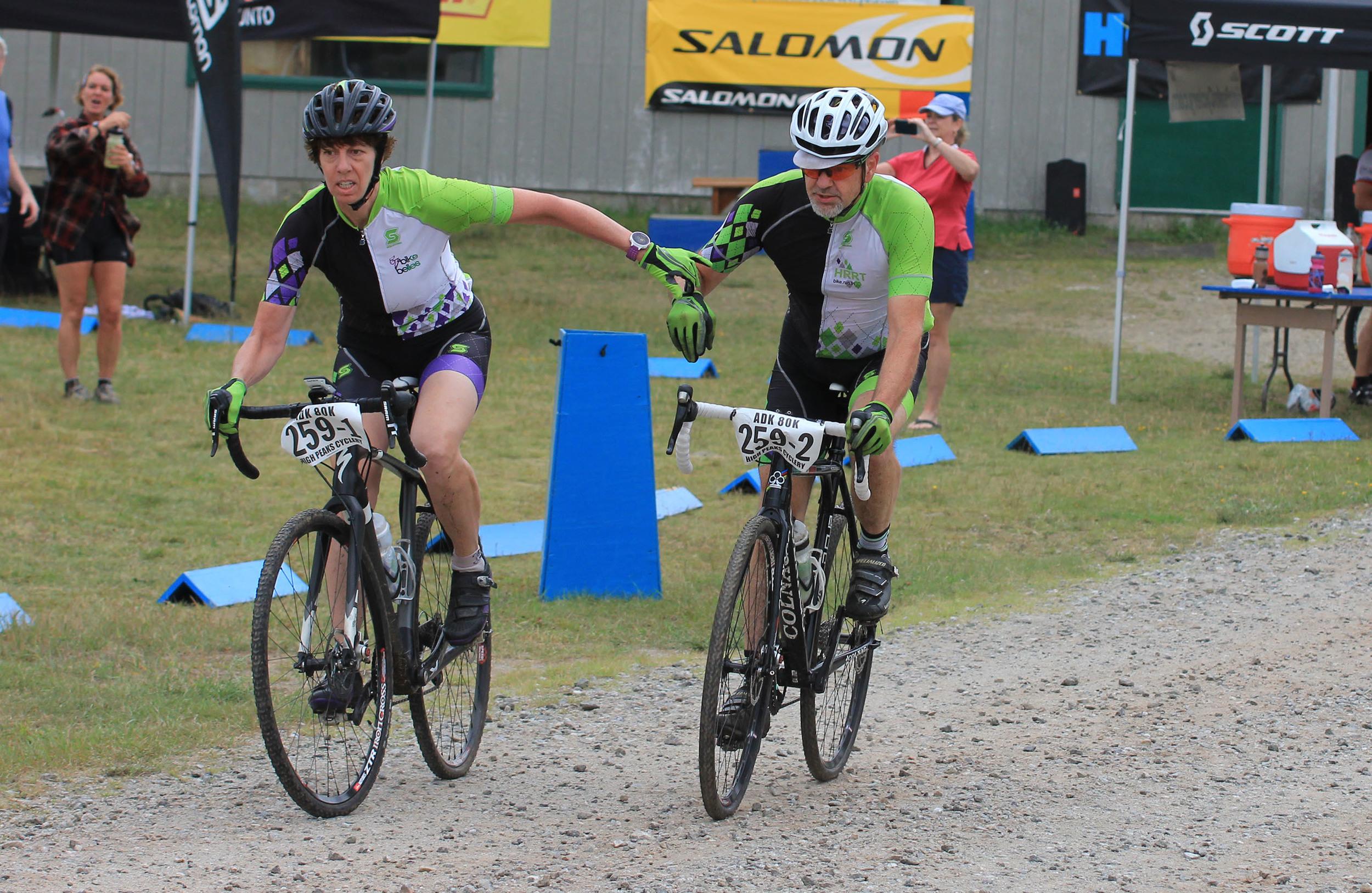 Jennifer Harvey and Don Massonne team handoff at 2015 ADK 80K. igh Peaks Cyclery
