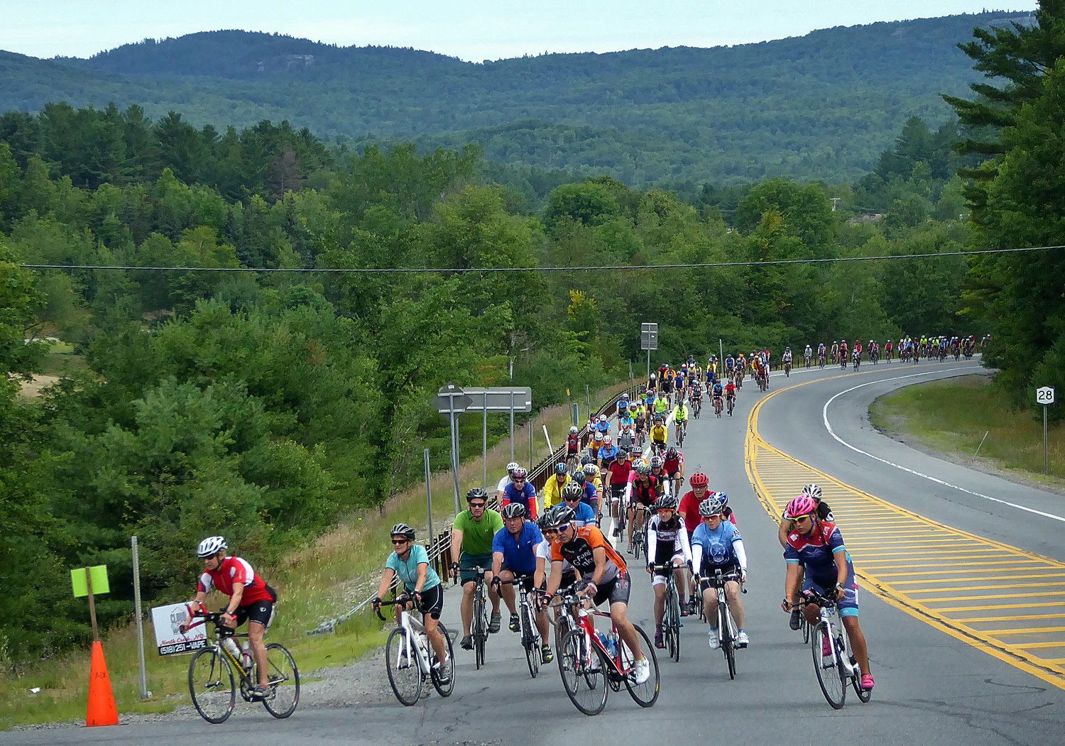 The ride leaders turn the corner from Route 28 onto Peaceful Valley Road as the 2016 Ididaride gets underway.   Copyright by Dave Kraus/ Krausgrafik.com