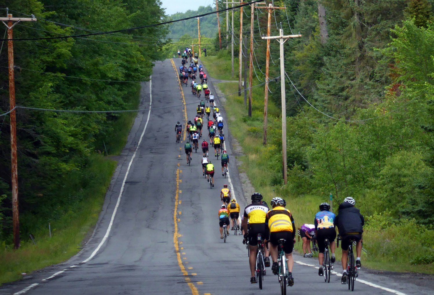 The pack gets stretched out as riders head south on Route 8 south of Sodom.   Copyright by Dave Kraus/ Krausgrafik.com