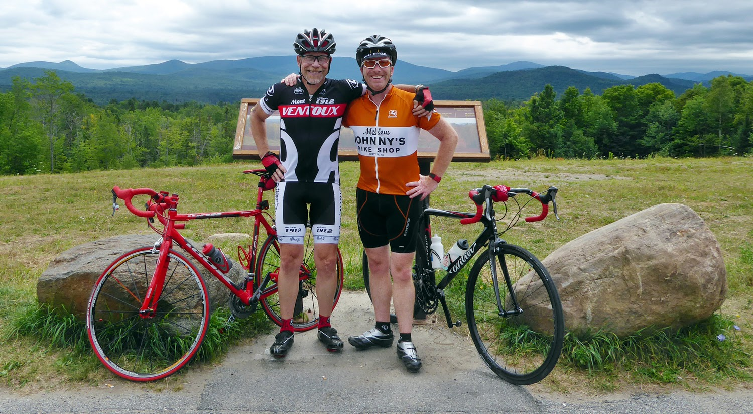 With the peaks in the background, friends Dave Kraus, let, and Evan Mayfield pose for a shot at the scenic overlook on Route 30 just south of the village of Indian Lake. Copyright by Dave Kraus/ Krausgrafik.com