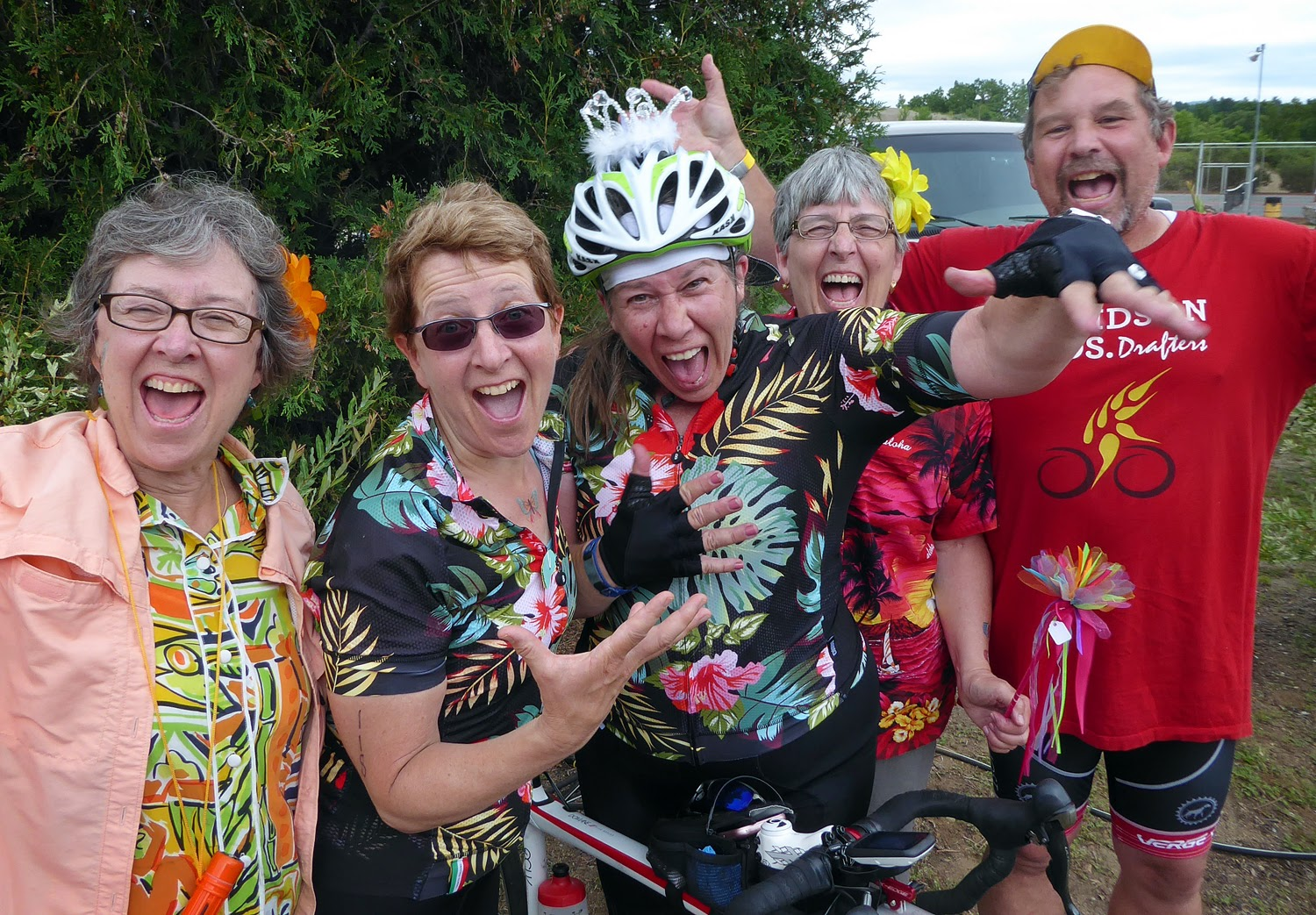 Ginny Paton, center, with crown on helmet, poses with friends at the finish in Ski Bowl Park. She came all the way from California to ride in her third Ididaride. Copyright by Dave Kraus/ Krausgrafik.com