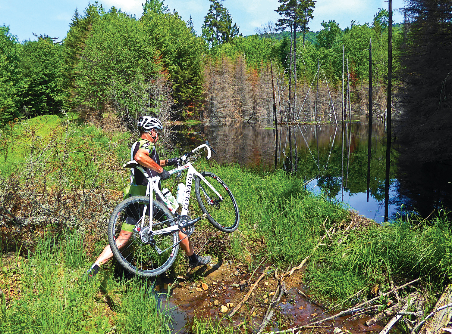 Some of the roads are now blocked by beaver dams and ponds, and some fancy footwork is necessary to continue the ride. © Dave Kraus/ Krausgrafik.com