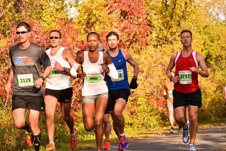 Winner Grace Kahura with group of half-marathoners. Neil Sergott