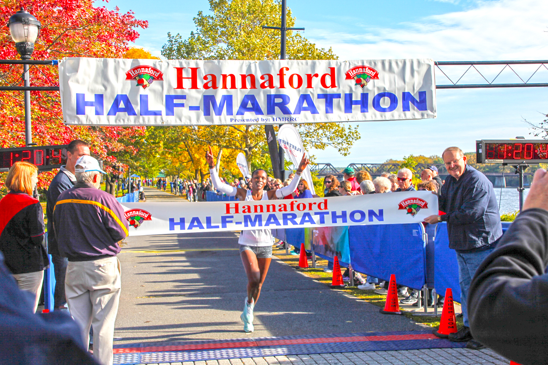 Grace Kahura breaks the tape in the 2015 Hannaford Half Marathon. Chris Bishop