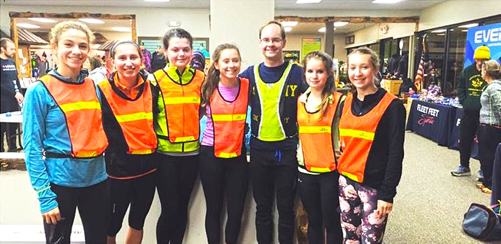 Albany Academy girls cross country team and their coach, Jonathan Catlett, at the 2015 24-Hour Fight Against Hunger.   Courtesy of Fleet Feet Sports