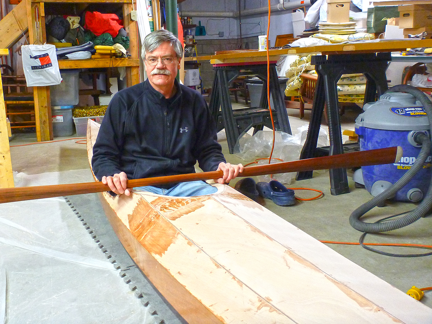 The author tries the fit of the developing kayak.   Mike Cavanaugh