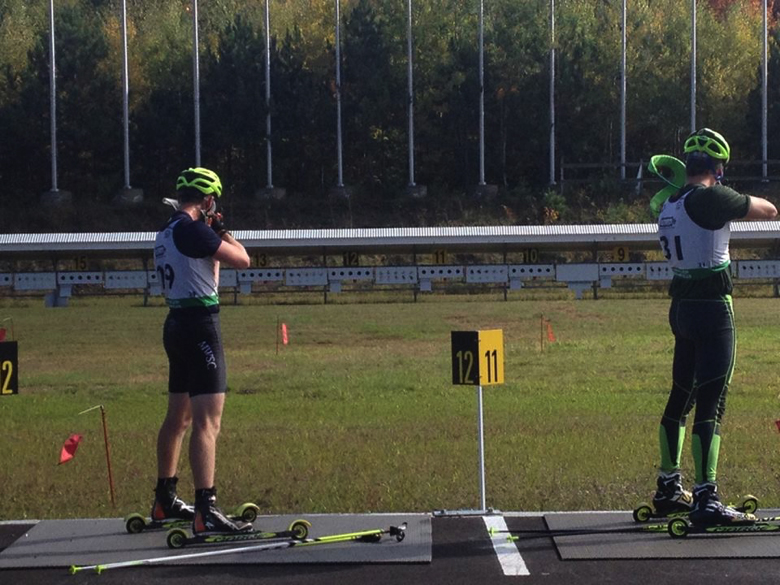 Brian Halligan and Ethan Dreissigacker of Burlington, Vt. on the range at a rollerski biathlon race.