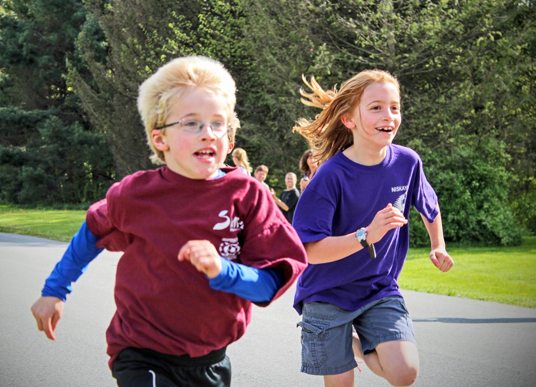 Three of four Binsfeld kids:   1)Matthew at 2012 CCRC fun run, 2) Sam playing Frisbee, and 3) Selah in an obstacle course.  Shelly Binsfeld