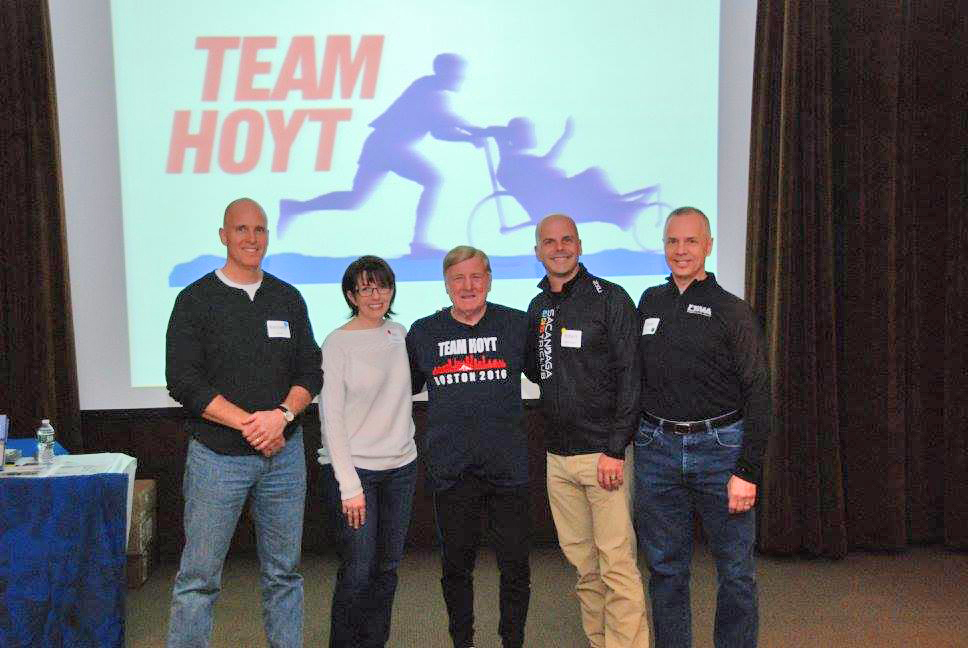Inspiring athlete and father, Dick Hoyt,   with Capital District, Saratoga, Sacandaga   and Bethlehem club presidents at the   Bone & Joint Center on March 23.  Neil Sergott/CDTC