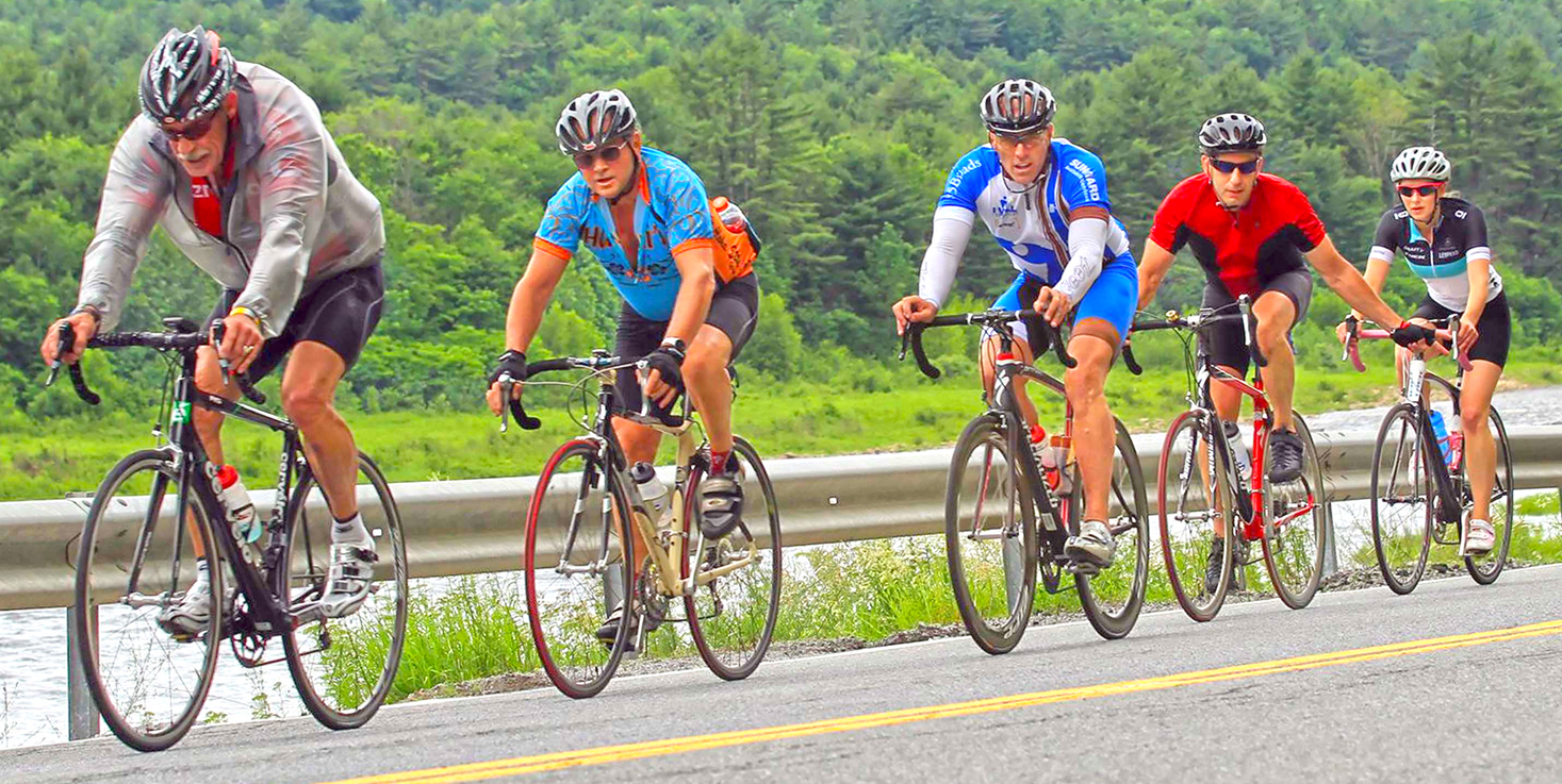 Single file riders along the Hudson River, near Warrensburg, during the Centurion Lake George 50-Mile Preview Ride.  Dave Kraus