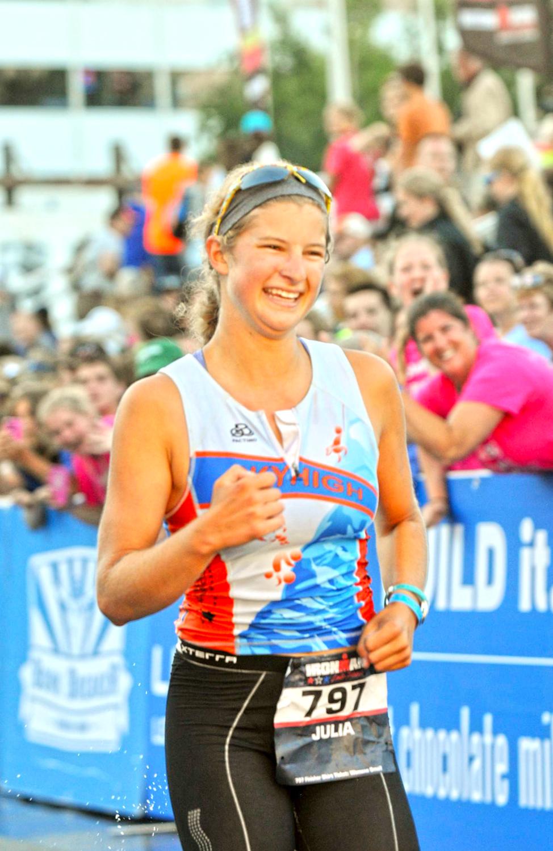 Julia at 2014 Ironman Lake Placid finish.