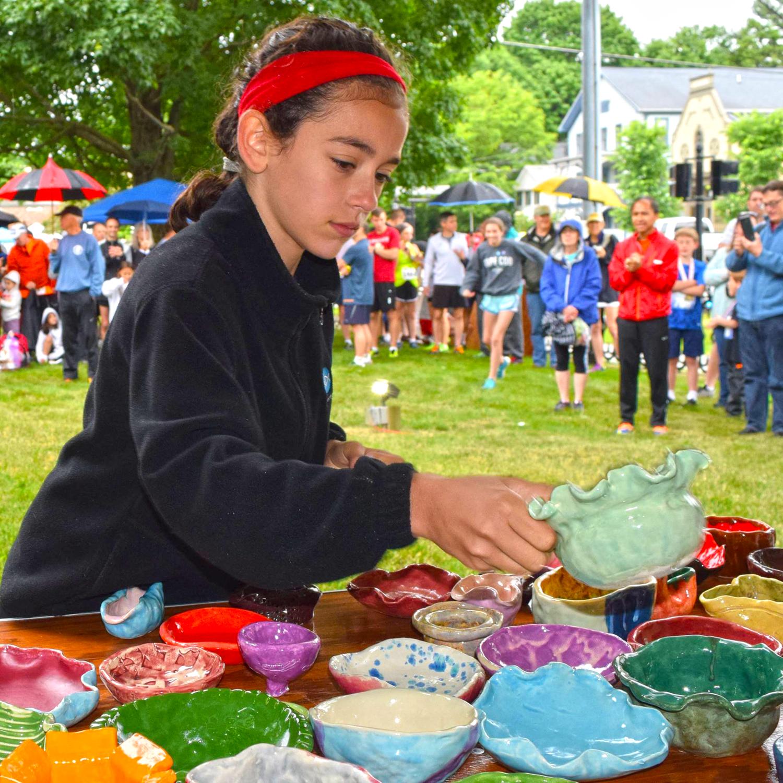 ● An OK 5K award winner chooses her pottery prize.  Chris Billingham