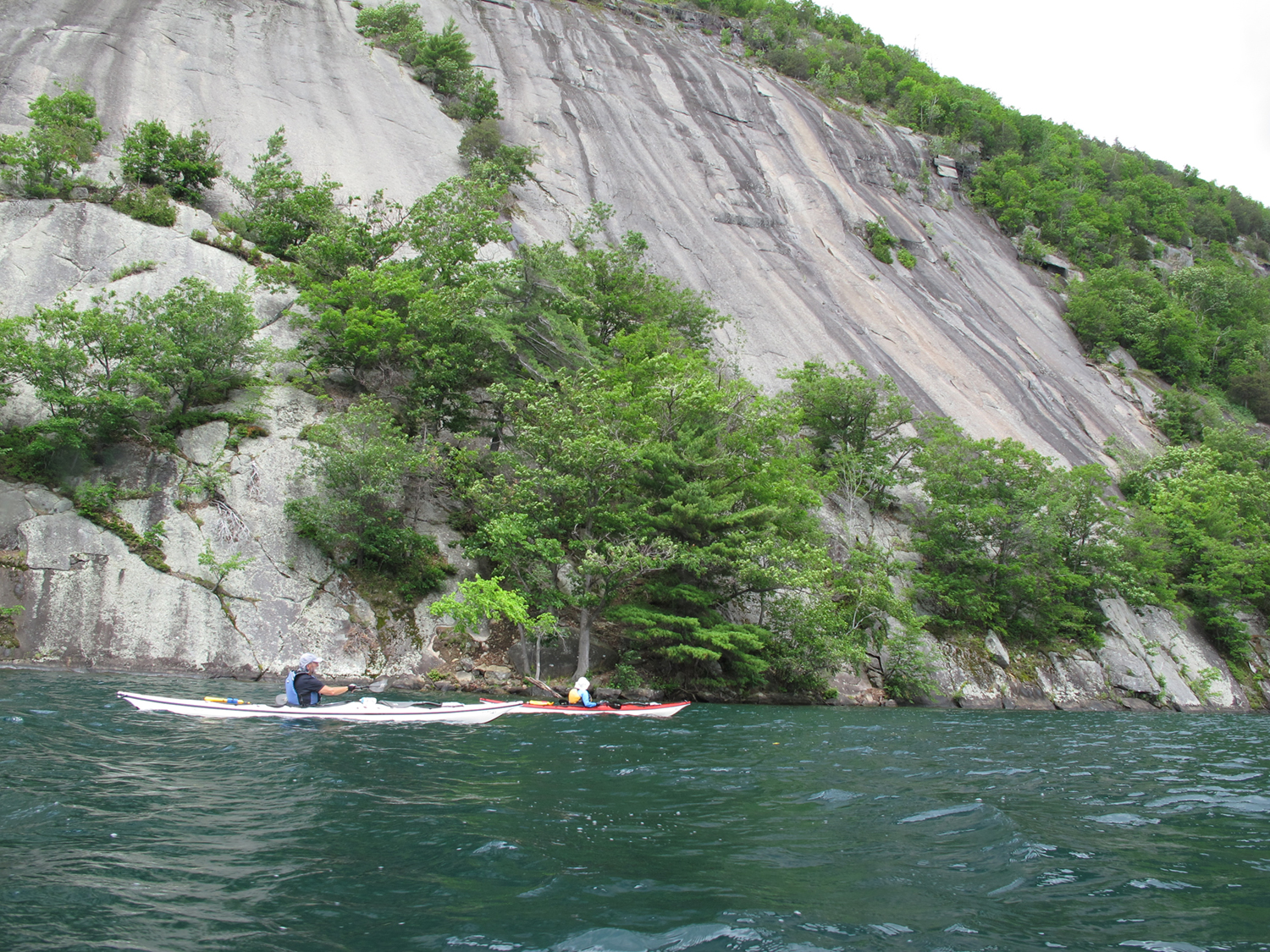 Julie Elson and Michael Kalin of Albany pass the face of Rogers Rock. Alan Mapes
