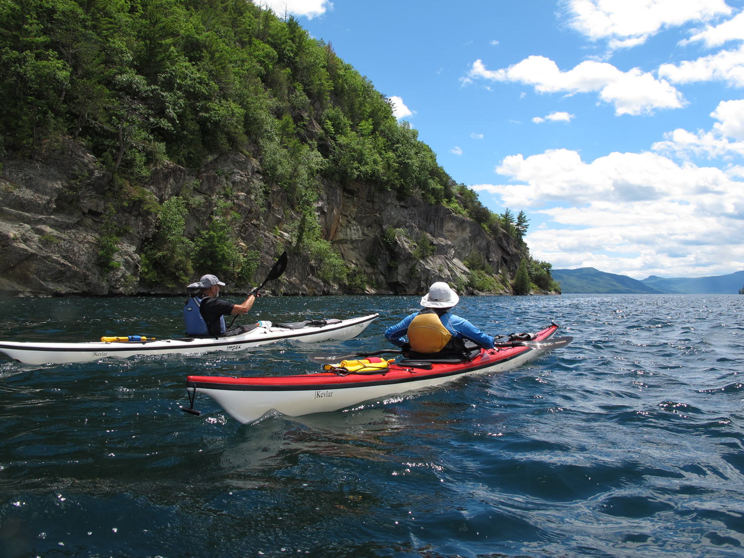 Julie and Michael heading for the point at Anthony's Nose, east shore of the lake.  Alan Mapes