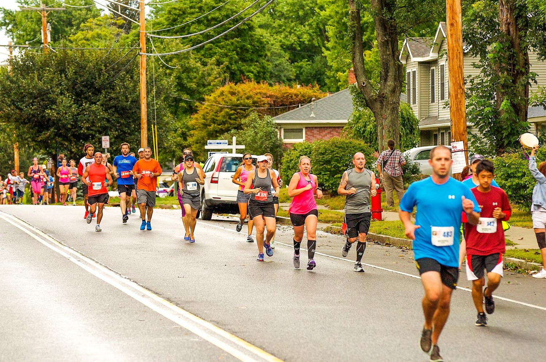 Running in the Whitehall neighborhood at Albany's 2016 Dunkin' Run. Peter VanBortel