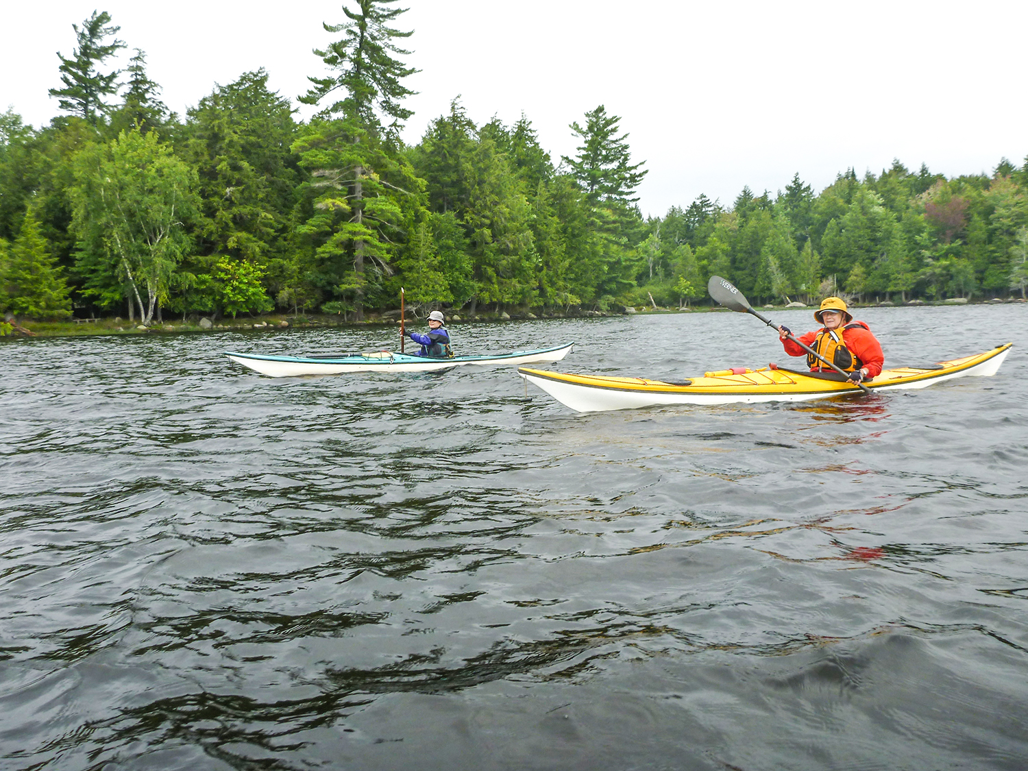 Julie Tan of NY City and Carol Doell of Westwood, NY along the shore of Raquette Lake.   Alan Mapes