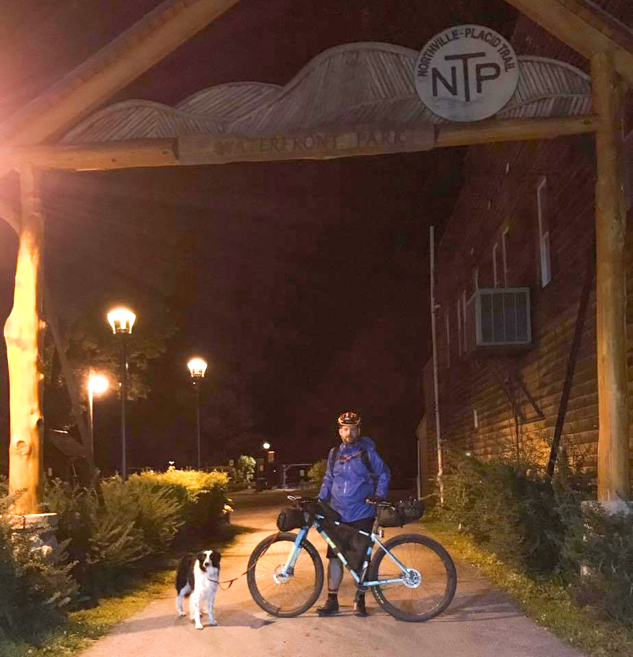 Festive evening at the finish line of The Adirondack Trail Ride at the Northville-Placid Trail arch in Northville.   Keegan Kramer