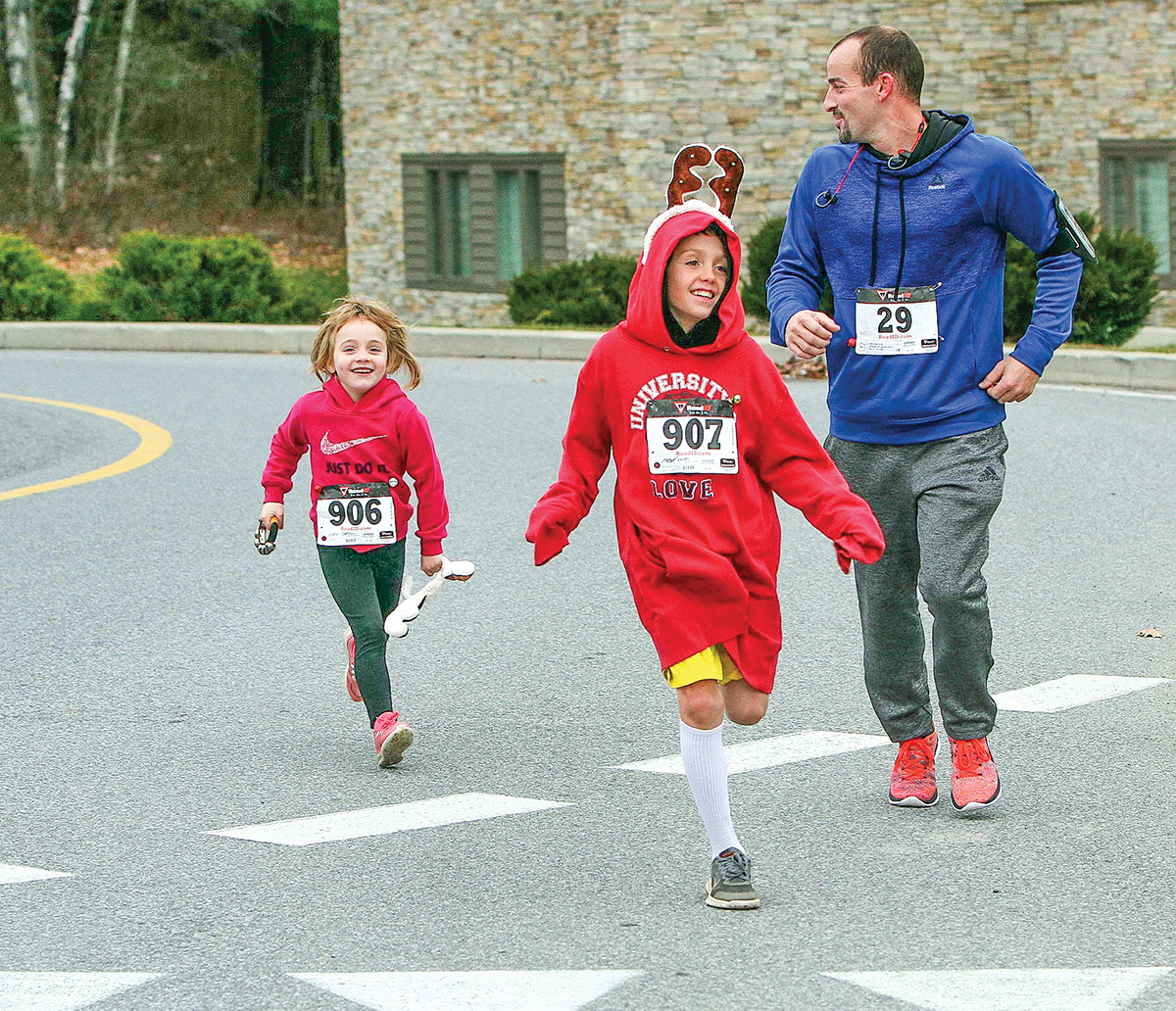 The Reindeer Run and Jr. Reindeer Run in Queensbury get runners into the holiday spirit.    Brian Teague/Fateague Fotos