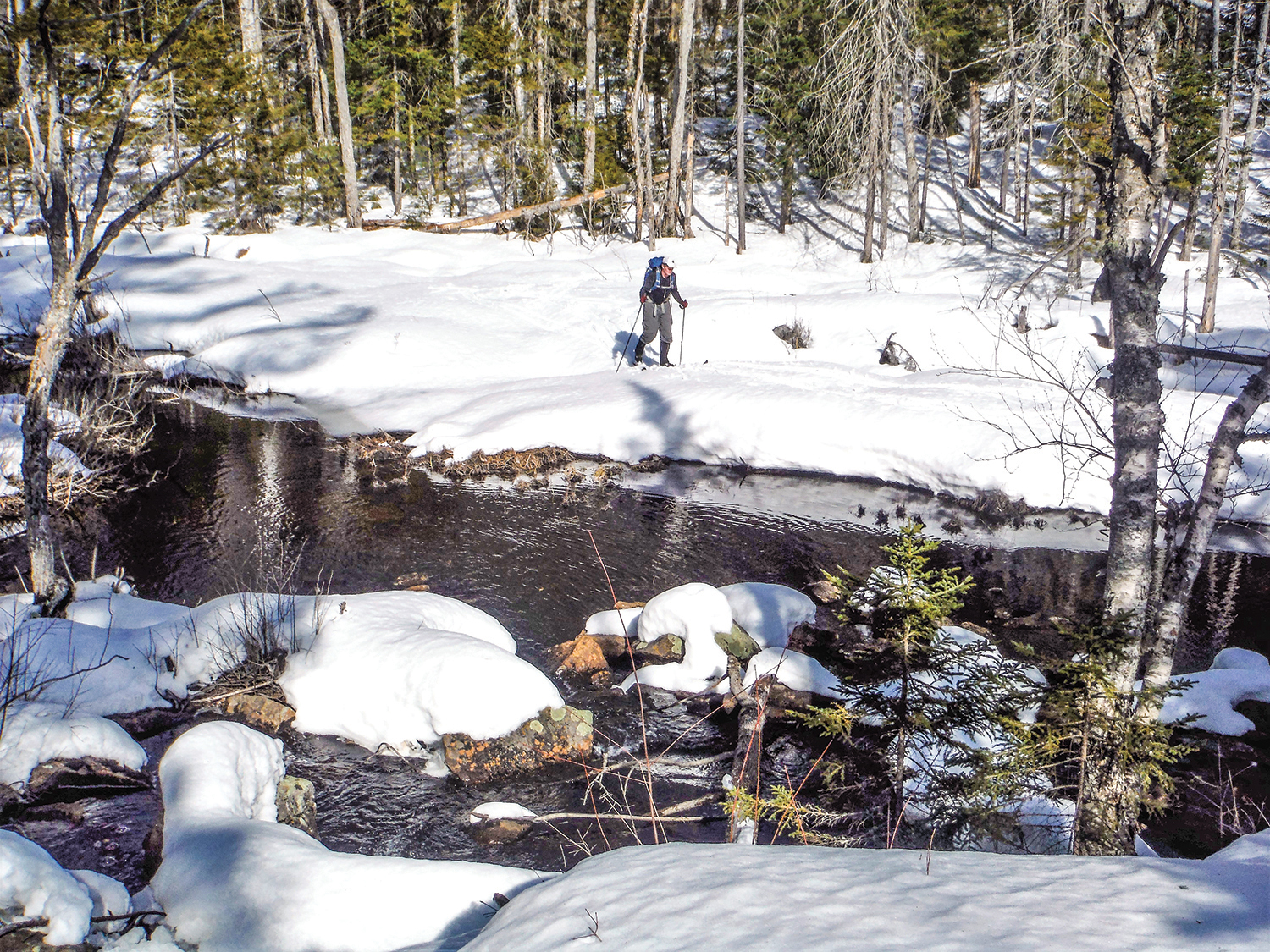 Skiing along the outlet of Cascade Pond.  Rich Macha