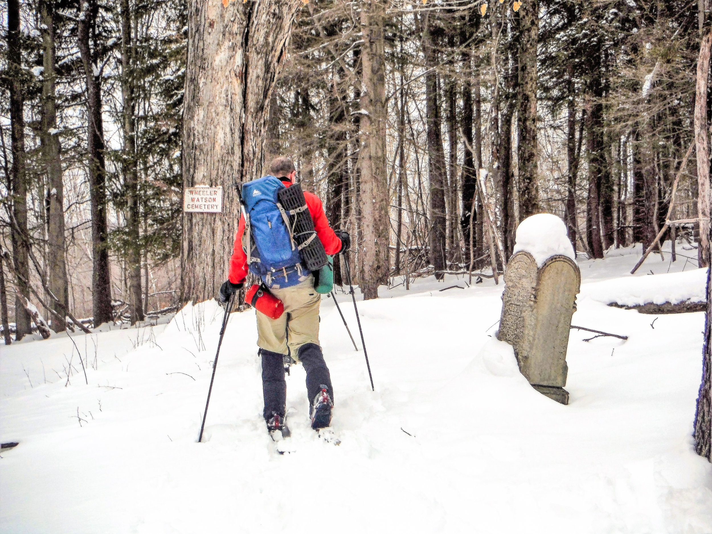 Passing by the old cemetery on the Wheeler-Watson Trail at the Huyck Preserve. Rich Macha