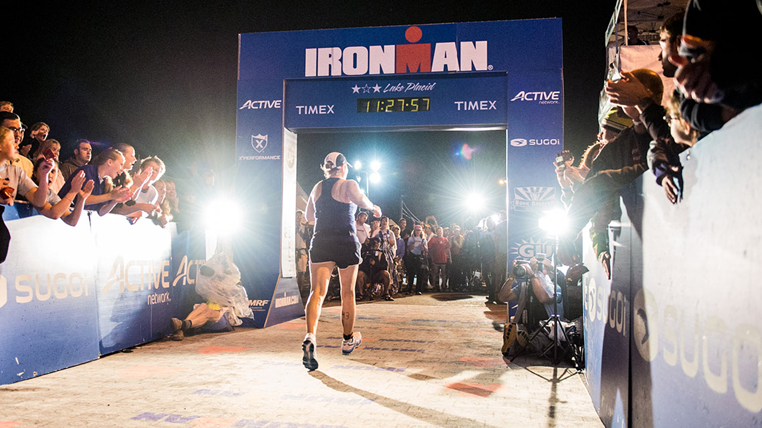 The midnight hour:  Ironman Lake Placid's classic finish line, 2013.   N2PHOTO Services/Nils Nilsen
