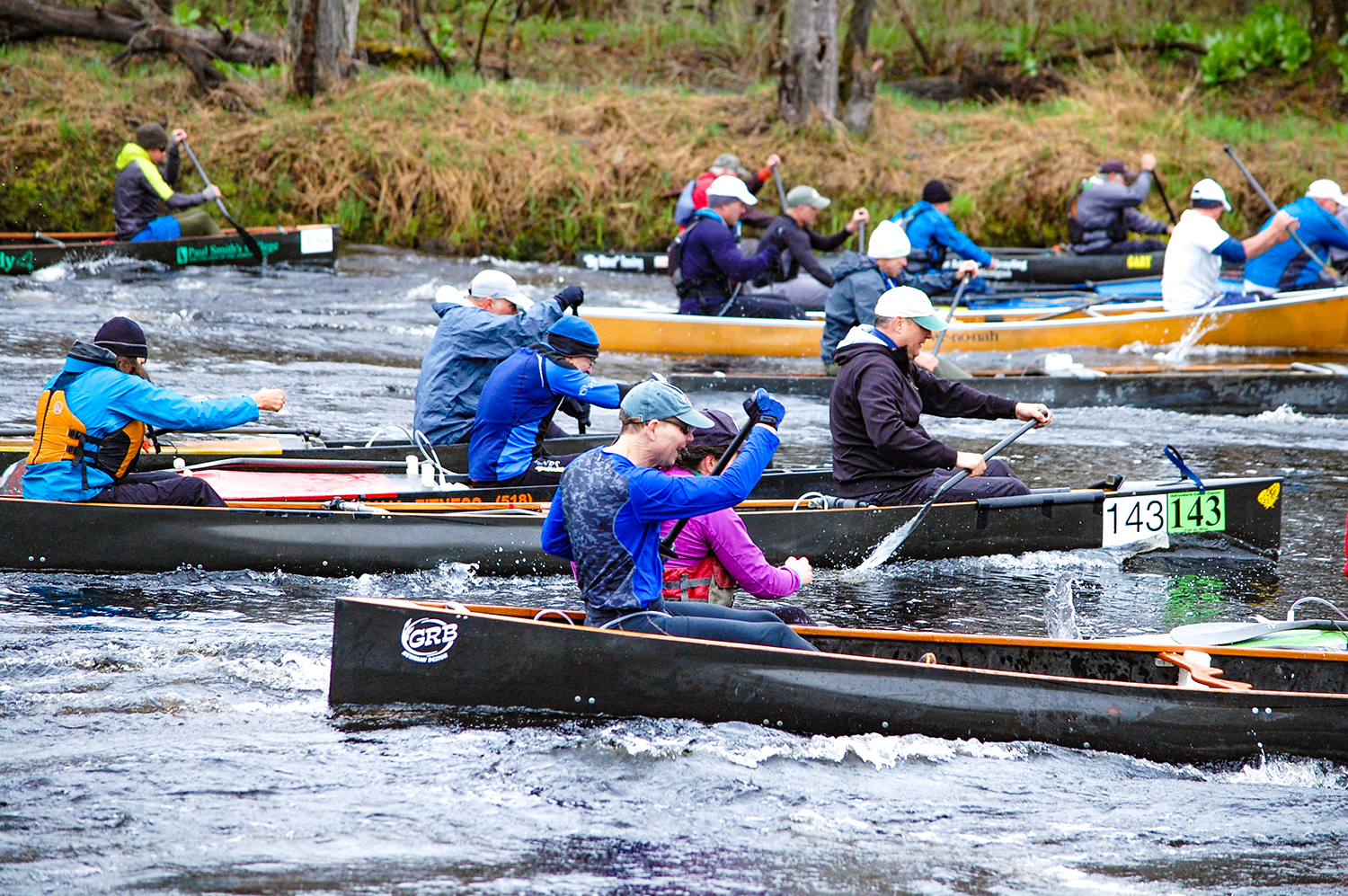 Tandem boats leave the start line at the Canton Canoe Weekend.   Blanche Town