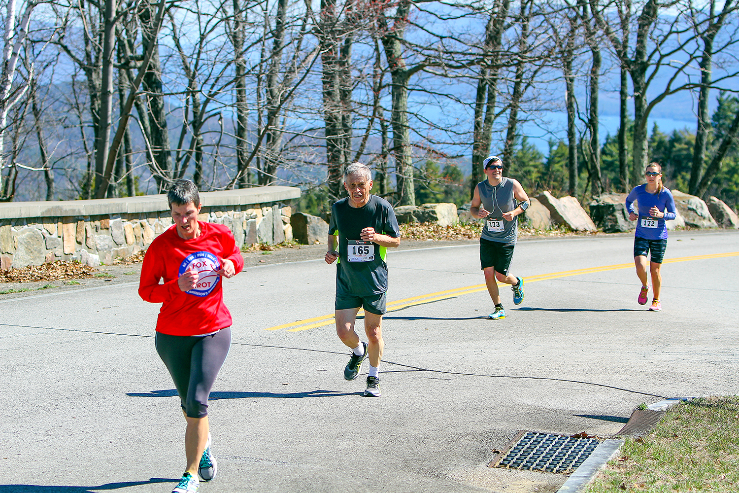 2016 Prospect Mountain Road Race  – Tracy Watson, David Forbes, Justin Grassi and Jennifer Grassi near the top with Lake George in the distance.  Brian Teague/Fateague Fotos