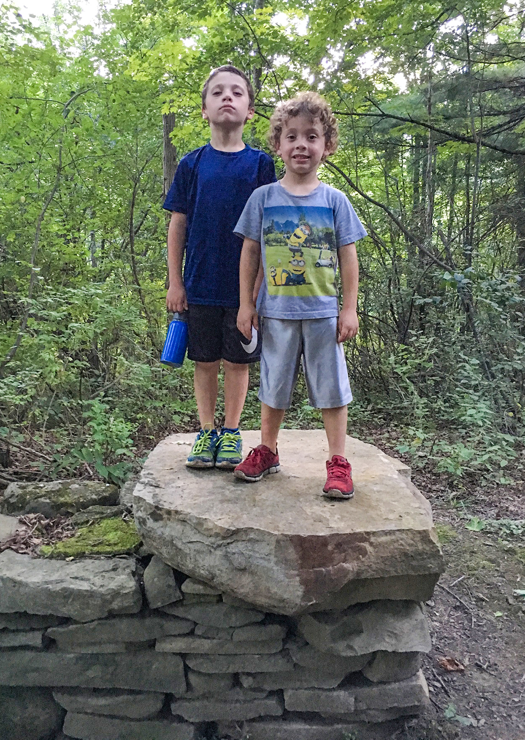 The Boys explore a stone structure at Bozen Kill on a summer evening.