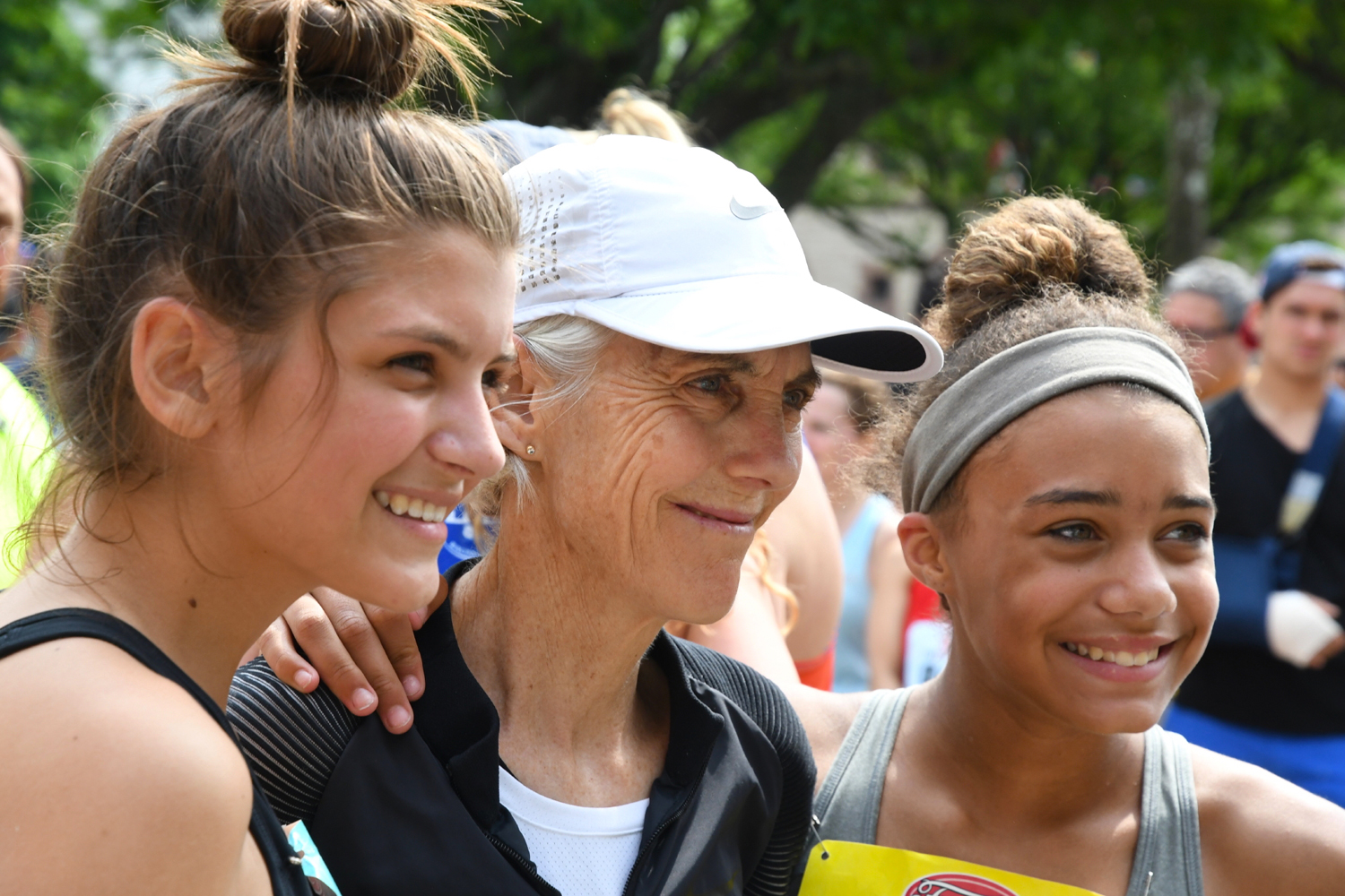 Joan Benoit Samuelson with young fans at 2018 Freihofer's Run.  Michael Farrell/Times Union