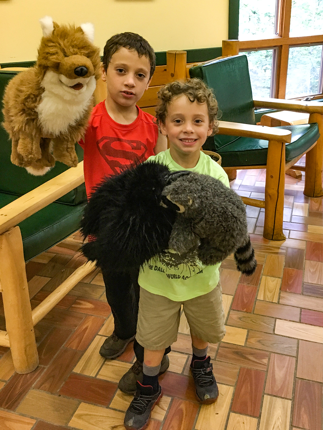 Conor and Theo with animal puppets at Adirondack Interpretive Center.  Tom O'Grady