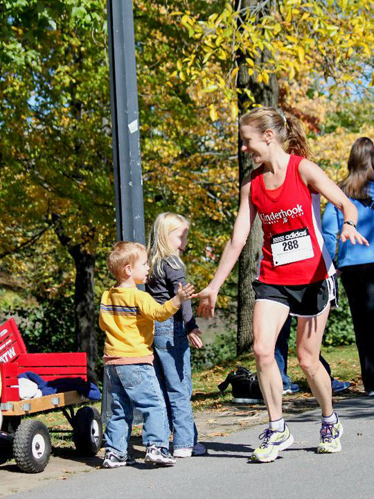 High fiving her kids at the 2010 Mohawk Hudson River Marathon finish line.