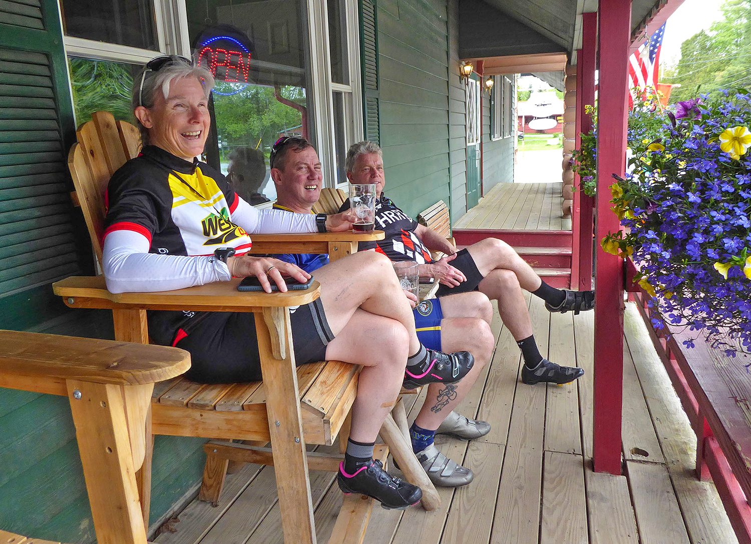 Elayne Livote enjoys the mid-ride stop at Fulton Chain Craft Brewery in Old Forge.  Dave Kraus/   KrausGrafik.com