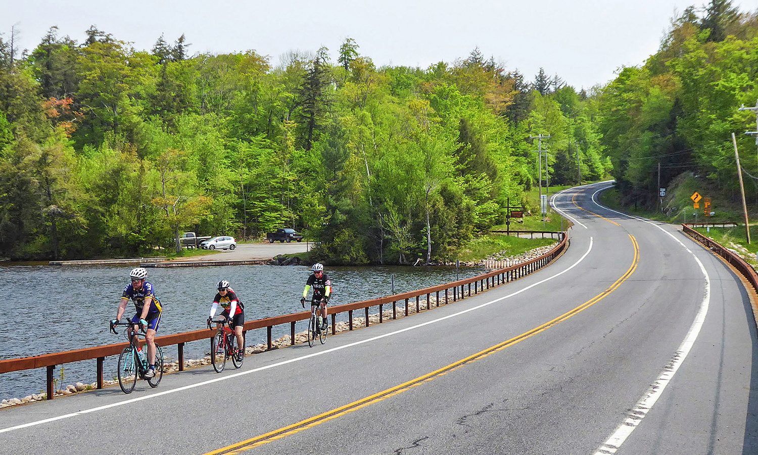 Passing Seventh Lake Boat Launch on Route 28: Mark Lurz of Clifton Park, Elayne Livote of Saratoga Springs, and Brian Stratton of Latham.  Dave Kraus/   KrausGrafik.com