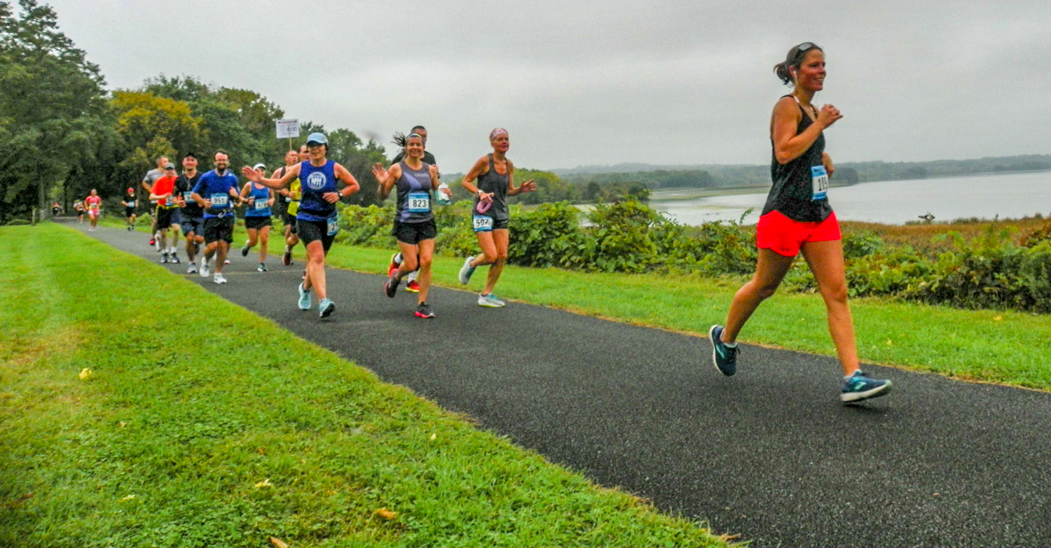 2018 Mohawk Hudson Marathon runners along bike path and Mohawk River.  Jack Berkery