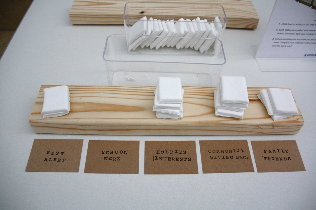 Originally developed for an event catering to middle school students, instructions asked participants to stack tiles to represent how they split their time over the past week, similar to how the artist stacked clay slabs to represent hours of work in a day.