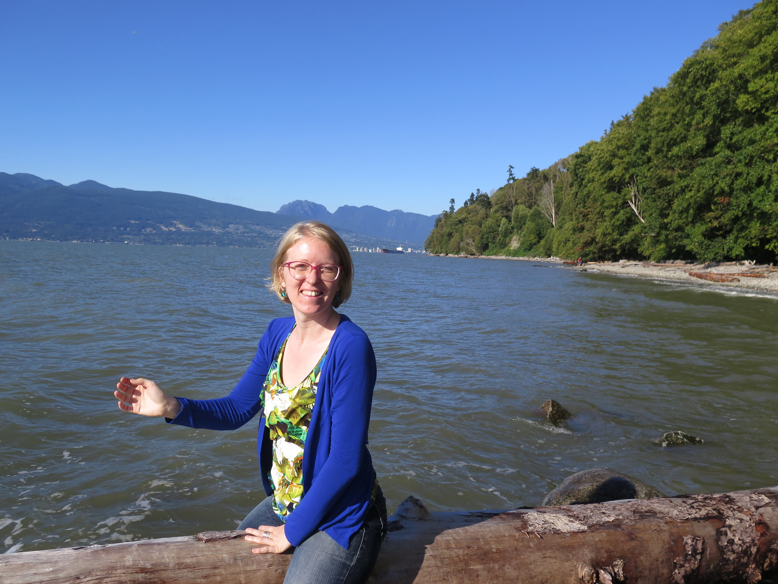 Feet dangling over the ocean at Wreck Beach in Vancouver, BC. (Photo: Michael Karenski)