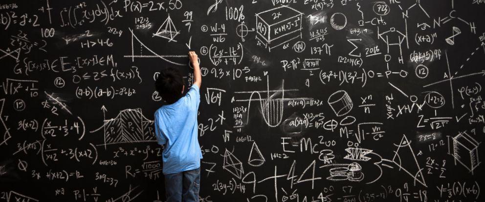 GTY_child_at_chalkboard_doing_math_jt_140315_12x5_992.jpg