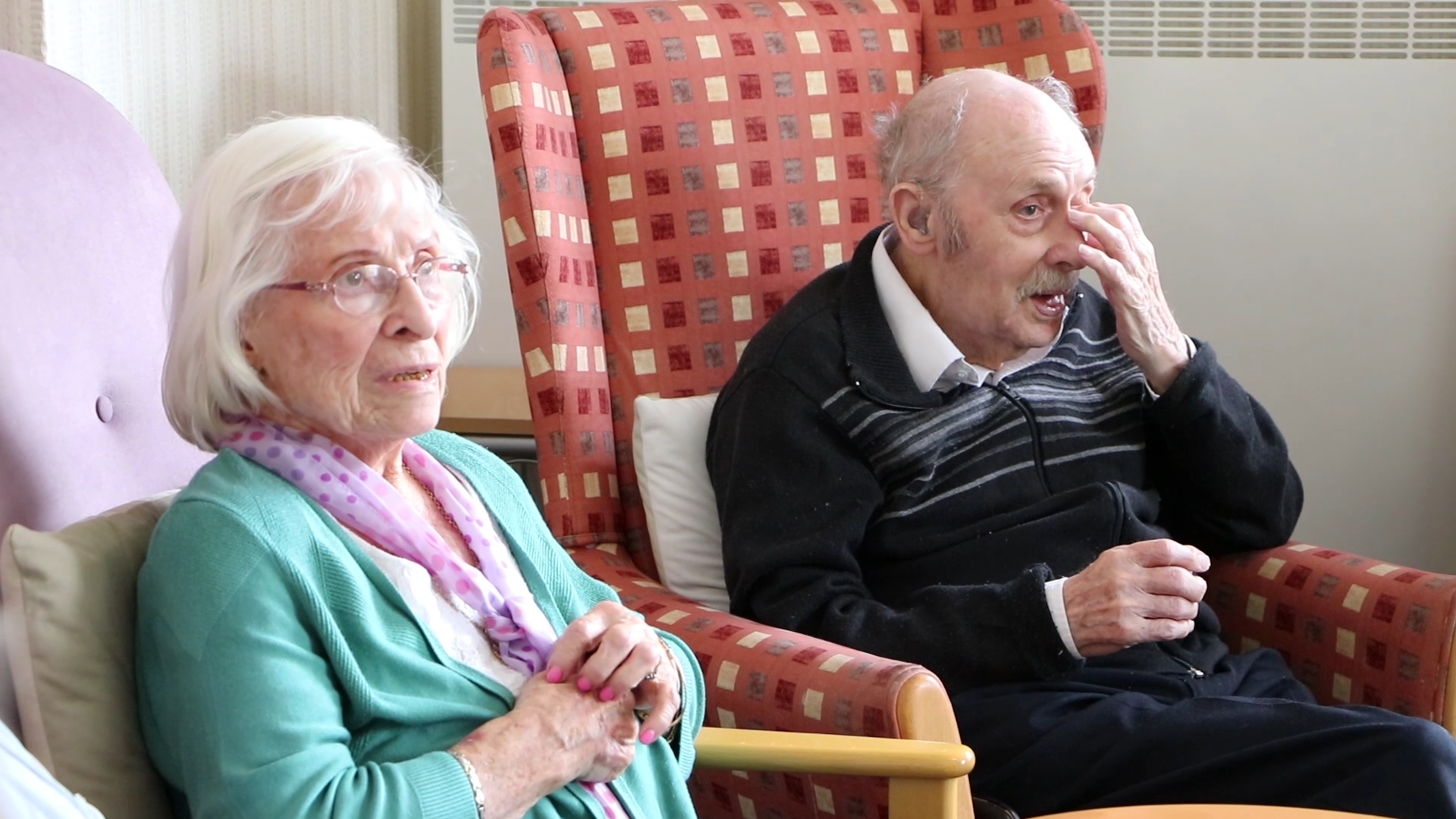 Visitors of the Orchard Dementia Centre in Chertsey enjoy a performance of Wartime classics from vintage singing trio Champagne at the Blitz.
