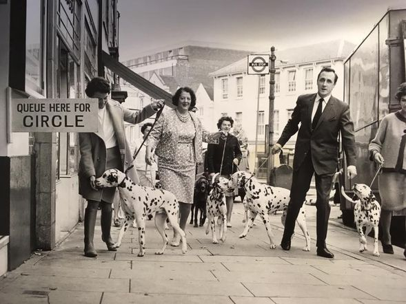 Guildford  Odeon Manager, Bryan Richardson (right) brings his Dalmatian 'Poddy' and other local residents for a promotional photo ahead of the release of Disney's 1969 film 101 Dalmatians.