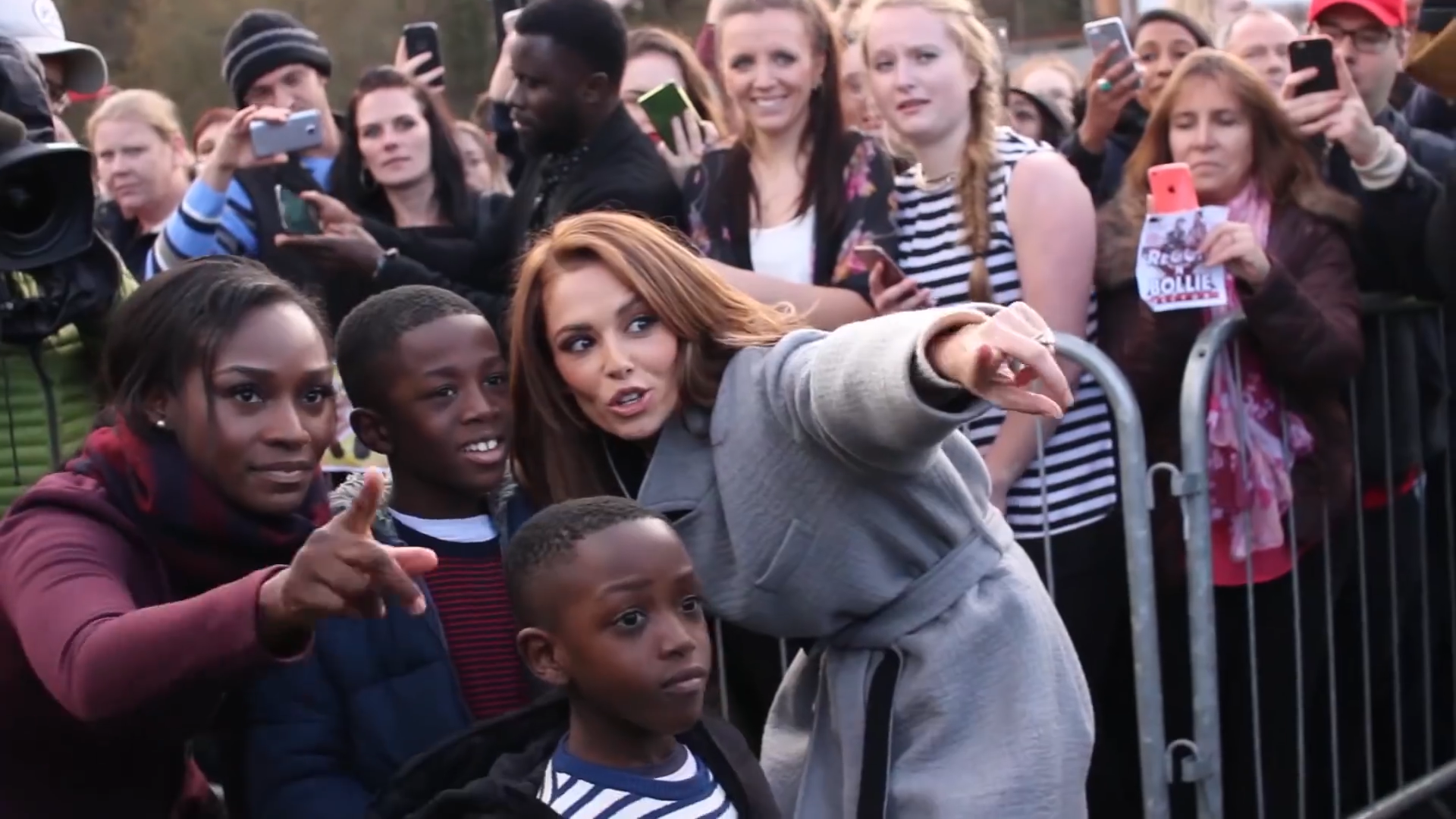Reggie and Bollie's Family pose with XFactor's Cheryl Cole in Farnborough for their homecoming gig.
