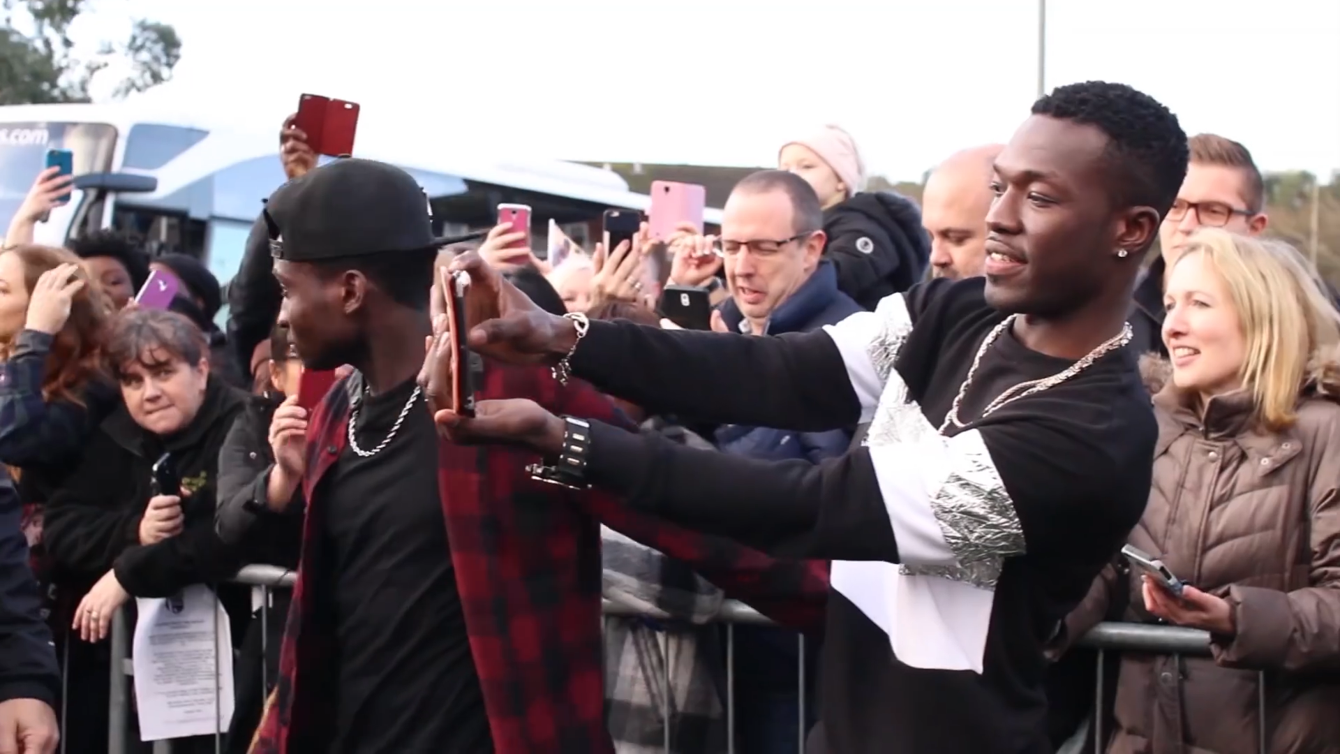 Reggie and Bollie from The XFactor take photographs with fans in Farnborough.