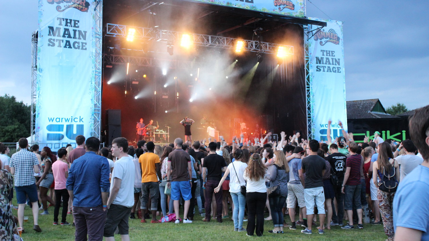 Students enjoy the main stage at Warwick University's Free Festival For Undergraduates, The Warwick Summer Party in 2014.