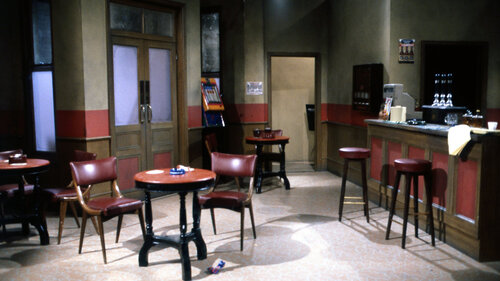 In which sitcom does this bar scene feature?