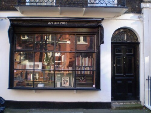 Which sitcom features this recognisable shop front?