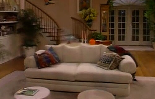 This large cream coloured living room was a feature in which popular sitcom?